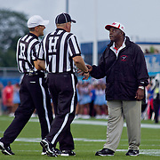 Delaware State Head Coach Kermit Blount (right) discuss the call with the game officials during a Week 2 NCAA football game against Delaware Saturday Sept. 08, 2012 in Newark Delaware.