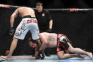 """LONDON, ENGLAND, OCTOBER 2010: Vinicius Queiroz (left) tries to shake off Rob Broughton during """"UFC 120: Bisping vs. Akiyama"""" inside the O2 Arena in Greenwich, London"""