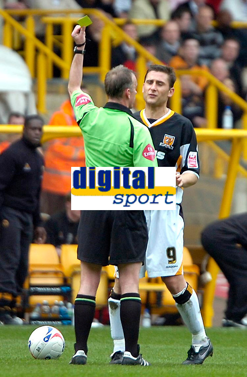 Photo: Ed Godden/Sportsbeat Images.<br />Wolverhampton Wanderers v Hull City. Coca Cola Championship. 09/04/2007. Hull's Nicky Forster receives a yellow card from Referee Phil Joslin.