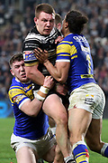 Hull FC back row forward Jordan Lane (26) is tacked by Leeds Rhinos full back Ashton Golding (1) during the Betfred Super League match between Hull FC and Leeds Rhinos at Kingston Communications Stadium, Hull, United Kingdom on 19 April 2018. Picture by Mick Atkins.