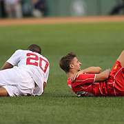 Fabio Borini, Liverpool, holds his shoulder, injured during a challenge with Seydou Keita, AS Roma, during the Liverpool Vs AS Roma friendly pre season football match at Fenway Park, Boston. USA. 23rd July 2014. Photo Tim Clayton