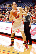 UD senior Justine Raterman (34) looks to pass as the Rhode Island Rams play the University of Dayton Flyers at UD Arena in Dayton, Saturday, January 7, 2012.