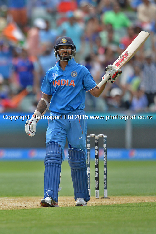 Indian batsman Shikhar Dhawan celebrates his fifty during the ICC Cricket World Cup match between India and Pakistan at Adelaide Oval in Adelaide, Australia. Sunday 15 February 2015. Copyright Photo: Raghavan Venugopal / www.photosport.co.nz