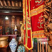 Ornate decorations, with a close-up of a colorful flag, at the Temple of the Jade Mountain (Ngoc Son Temple) on Hoan Kiem Lake in the heart of Hanoi's Old Quarter. The temple was established on the small Jade Island near the northern shore of the lake in the 18th century and is in honor of the 13-century military leader Tran Hung Dao.