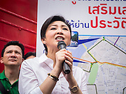 17 FEBRUARY 2013 - BANGKOK, THAILAND:  Thai Prime Minister YINGLUCK SHINAWATRA campaigns for Pongsapat Pongchareon in Bangkok Sunday. Pol General Pongsapat Pongcharoen, a former deputy national police chief who also served as secretary-general of the Narcotics Control Board is the Pheu Thai Party candidate in the upcoming Bangkok governor's election. (He resigned from the police force to run for Governor.) Former Prime Minister Thaksin Shinawatra reportedly recruited Pongsapat. Most of Thailand's reputable polls have reported that Pongsapat is leading in the race and likely to defeat Sukhumbhand Paribatra, the Thai Democrats' candidate and incumbent. The loss of Bangkok would be a serious blow to the Democrats, whose base is the Bangkok area.     PHOTO BY JACK KURTZ