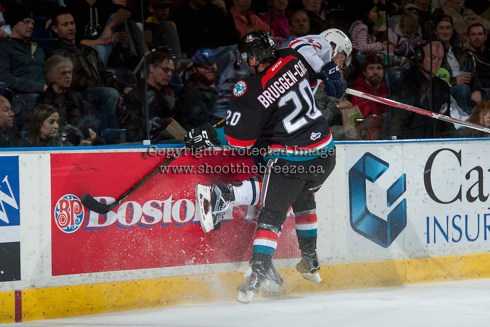 KELOWNA, CANADA - NOVEMBER 1: Conner Bruggen-Cate #20 of the Kelowna Rockets checks Ondrej Vala #42 of the Kamloops Blazers into the boards during second period on November 1, 2016 at Prospera Place in Kelowna, British Columbia, Canada.  (Photo by Marissa Baecker/Shoot the Breeze)  *** Local Caption ***