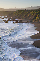Waves crashing on  sand beach on Sonoma Coast California