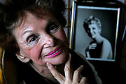 "Elaine Dundy, 80, poses with an old photo of herself in the 1950s, at her home in Los Angeles. Dundy, former wife of Kenneth Tynan, has a flash of success as a novelist in the 1950s with her book ""The Dud Avocado."" Now, the novel has been re-issued, and the movie is in the works."