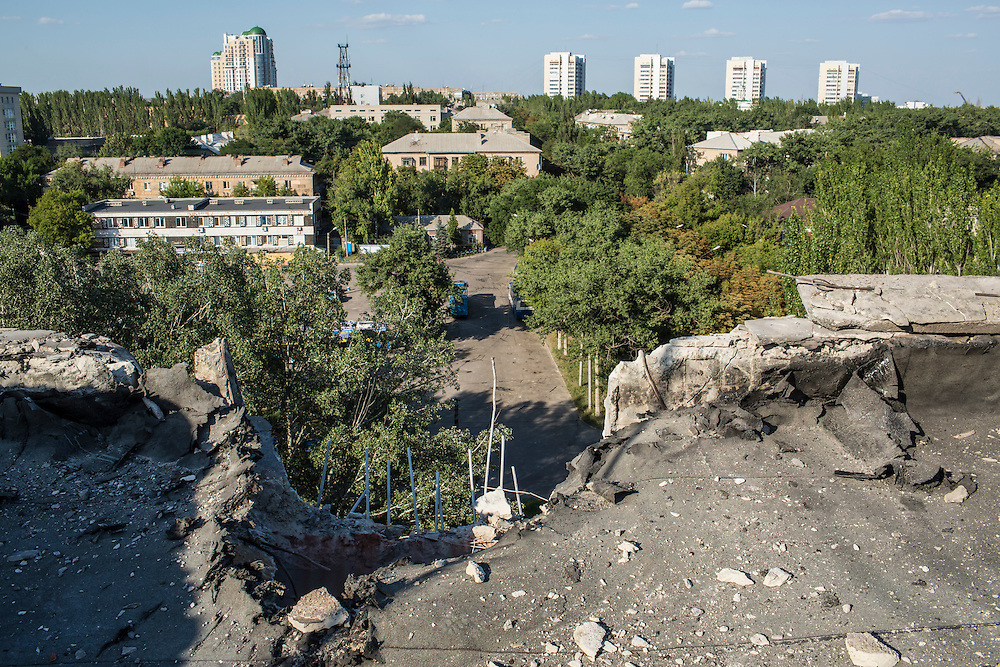 A piece of the roof is missing from an apartment building which was hit by a suspected grad rocket strike on Tuesday, July 29, 2014 in Donetsk, Ukraine.