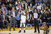 Golden State Warriors head coach Steve Kerr coaches Golden State Warriors forward Kevin Durant (35) during a Utah Jazz free throw attempt at Oracle Arena in Oakland, Calif., on December 27, 2017. (Stan Olszewski/Special to S.F. Examiner)