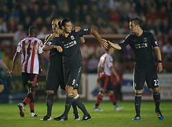 EXETER, ENGLAND - Wednesday, August 24, 2011: Liverpool's Andy Carroll celebrates scoring the first goal against against Exeter City with Danny Wilson during the Football League Cup 2nd Round match at St James Park. (Pic by David Rawcliffe/Propaganda)
