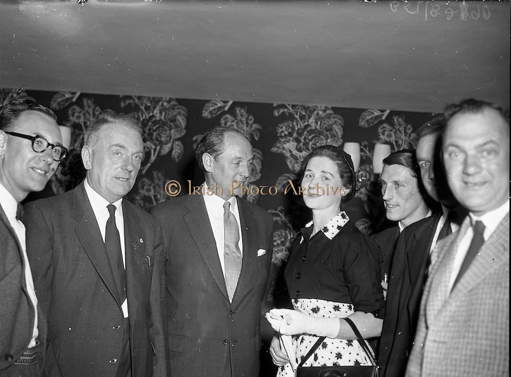 "27/05/1959<br /> 05/27/1959<br /> 27 May 1959<br /> Presentation of Esso Perpetual Trophy to the Listowel Drama Group at the Shelbourne Hotel, Dublin. The trophy and replicas for the  All Ireland Amateur Dram festival were presented by Mr. T.F. Laurie, Chairman and Managing Director of Esso Petroleum Co. (Ireland) Ltd. at a special luncheon. The Listowel group won the competition with their performance of the 3 Act play ""Sive"" by John B. Keane. Picture shows chatting at the reception before the presentation (l-r): William Kearney, cast member;  Deputy Dan Moloney T.D. for Kerry North; Mr jack Lynch T.D., Minister for Education and Miss Nora Relihan, cast member."