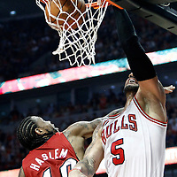 18 May 2011: Chicago Bulls power forward Carlos Boozer (5) dunks the ball over Miami Heat power forward Udonis Haslem (40) during the Miami Heat 85-75 victory over the Chicago Bulls, during game 2 of the Eastern Conference finals at the United Center, Chicago, Illinois, USA.