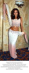 Singer MYLEEN KLASS at a dinner in London on 13th April 2004.PTF 93