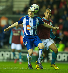 WIGAN, ENGLAND - Tuesday, March 16, 2010: Aston Villa's Gabriel Agbonlahor and Wigan Athletic's Gary Caldwell during the Premiership match at the DW Stadium. (Photo by David Rawcliffe/Propaganda)