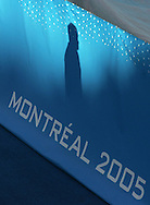 The shadow of an Fina official walks by a banner at the end of an event at the FINA World Championships in Montreal, Canada, Friday 29 July 2005.