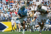 05/25/2014 - Baltimore, Md. - Tufts midfielder Chris Sawyer, A16, gets checked by Salisbury long stick midfielder Zeke Smith in Tufts' 12-9 win over Salisbury to win the NCAA Division III Men's Lacrosse National Championship game at M&T Bank Stadium on May 25, 2014. (Kelvin Ma/Tufts University)