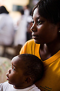 Monica Dahlu and her 10-month-old boy Lloyd Gyimah listen to counseling from nurse Eugenia Beatson at the Osu Maternity Home in Accra, Ghana on Tuesday June 16, 2009.
