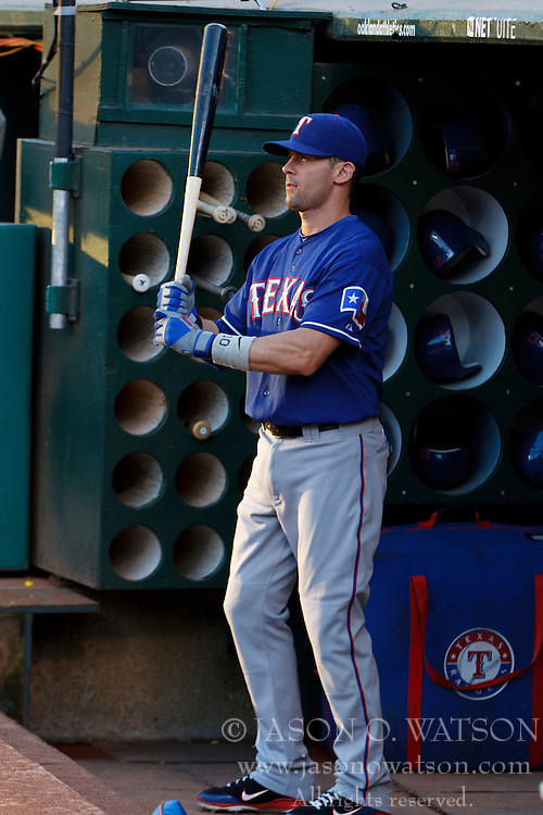 September 20, 2011; Oakland, CA, USA;  Texas Rangers designated hitter Michael Young (10) stands in the dugout before the game against the Oakland Athletics at O.co Coliseum.  Texas defeated Oakland 7-2.
