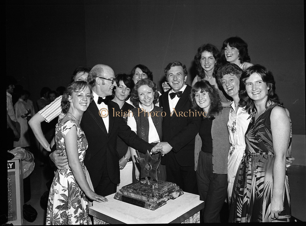 "Tops of the Town Final.   (N79)..1981..31.05.1981..05.31.1981..31st May 1981..The John Player sponsored Tops Of The Town competition had its final tonight in the Gaiety Theatre, Dublin.The overall winners were the Limerick Insurances Group...The cast and producer, Mr Douglas Howell, of the Limerick Insurances Group are congratulated on their win in the ""Tops"" by runner up. Mr Raymond Kirk, St Joseph's Youth Club, Strabane."