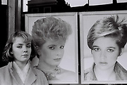 Teenage girl outside a Shepherds Bush Hairdressers, London, UK, 1984