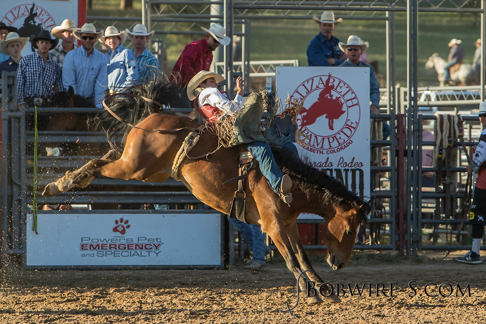 Bareback bronc rider Paden Hurst rides Summit Pro Rodeo's Shamrock in the second performance of the Elizabeth Stampede on Saturday, June 2, 2018.
