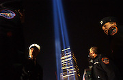 Firefighters from Ladder 124 see the Twin towers of light from Ground Zero in Manhattan, NY. 3/11/2002 Photo by Jennifer S. Altman