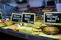 """ROME, ITALY - 7 January 2014: Paninis and bagels are sold at Bar Necci at lunch time, an airy bar and restaurant that was made famous by the Italian director Pier Paolo Pasolini who shot parts of his 1961 film """"Accattone"""" in the Pigneto neighborhood of Rome, Italy, on February 7th 2014."""