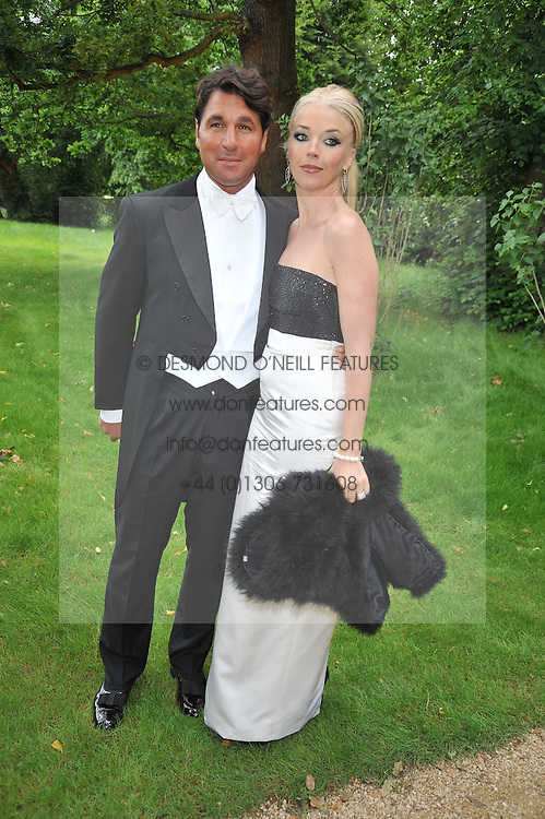 TAMARA BECKWITH and her husband GEORGE VERONI at the Raisa Gorbachev Foundation fourth annual fundraising gala dinner held at Stud House, Hampton Court, Surrey on 6th June 2009.