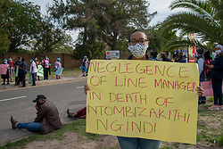"""I tested positive,"" says Jemimah Mokubunge, on Friday, June 5, 2020, holding a (health-union SAFTU) sign that alleges that Tygerberg nurse Ntombizakithi Ngidi, who died of COVID-19 related illness, was initially refused medical care by her superiors. <br /> Mokubunge is a clerk handling patients' hospital records. ""Sometimes we get coronavirus patients' records,"" she said. ""And there was no sanitizer. Most of the people (in the department) got positive.""<br /> When the first person in her department contracted the virus, that employee was the one to notify her colleagues by calling them from isolation, explains Mokubunge. ""We asked to be tested,"" she said. But ""they refused us to get tested."" <br /> ""Only when the second person tested positive were we allowed to get tested,"" she said. ""I tested positive. I did not feel sick."" <br /> Mokubunge lives with her husband, mother and nine-month old baby. ""They said I could isolate with the baby,"" she said she was advised by the health professionals.  <br /> After quarantining at home for 14 days, Mokubunge was told to go back to work. No retesting was available, she said. Her family tested negative for the virus. <br /> Hospital workers demonstrate outside Tygerberg Hospital, in Cape Town, to bring their plight to the attention of President Cyril Ramaphosa, as he visited the Cape Town Province. PHOTO: EVA-LOTTA JANSSON"