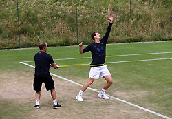 Andy Murray during a training session with fitness coach Matt Little on day two of the Wimbledon Championships at The All England Lawn Tennis and Croquet Club, Wimbledon.