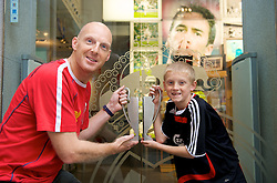 MADRID, SPAIN - Wednesday, October 22, 2008: Liverpool supporter Rob Cuncliffe and his son Arran hold the European Cup in Madrid ahead of the UEFA Champions League Group D match against Club Atletico de Madrid. (Photo by David Rawcliffe/Propaganda)