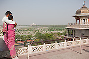 A couple is overlooking the plain next to the Taj Mahal, the area of the controversial 'Taj Heritage Corridor', sitting between the Agra Fort and the Taj, and next to the heavily polluted and dry Yamuna River, in Agra.