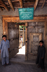 JURM, 28 July 2005..Children standing at the doorway of Jurm Vocational Training Centre.....According to United Nations Population Fund, Afghanistan has among the world?s highest rates of maternal mortality, and Badakhshan has the highest rates ever recorded anywhere in the world, with one mother dying in every 15 births. Underage marriage is one of the primary causes of maternal mortality.....The VTC aim is to make women aware of their onwn status as Mother and as Woman, by giving lessons on maternity, reproductive health, family planning and post-natal issues...The VTC is funded by UNFPA and implemented by IBNSINA...