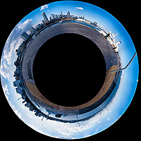 Little Planet View of the Yokohama, Japan Skyline from the Osanbashi Pier. Composite of 37 images taken with a  Fuji X-T1 camera and 35 mm f/1.4 lens (ISO 200, 35 mm, f/11, 1/250 sec) using a 360° Mindarin Astro rotating tripod head. Raw images processed with Capture One Pro and the Little Planet view created using AutoPano Giga Pro.