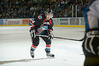 KELOWNA, CANADA, NOVEMBER 25: Cody Chikie #14 of the Kelowna Rockets skates on the ice as the Kootenay Ice visit the Kelowna Rockets  on November 25, 2011 at Prospera Place in Kelowna, British Columbia, Canada (Photo by Marissa Baecker/Shoot the Breeze) *** Local Caption *** Cody Chikie;
