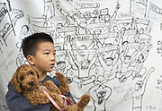 A boy with his puppy in front of a placard featuring residents' protest against the THAAD at Soseong-ri village in Seongju, about 300 km southeast of Seoul, South Korea, October 4, 2017. Soseong-ri village is about 2 km away from a U.S. military base, a former golf course of Lotte, where the U.S. Army installed the Terminal High Altitude Area Defense (THAAD) system after South Korean government decided to install the U.S. missile defense shield as a countermeasure to nuclear and missile tests of North Korea while residents and civic groups were protesting against the installation. Photo by Lee Jae-Won (SOUTH KOREA) www.leejaewonpix.com