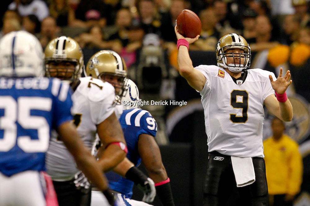 October 23, 2011; New Orleans, LA, USA; New Orleans Saints quarterback Drew Brees (9) throws against the Indianapolis Colts during the first quarter of a game at the Mercedes-Benz Superdome. Mandatory Credit: Derick E. Hingle-US PRESSWIRE / © Derick E. Hingle 2011