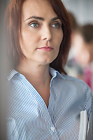 Mid-adult businesswoman looking away in office
