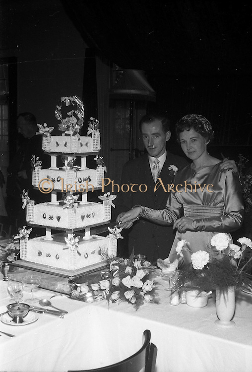 08/10/1959<br /> 10/08/1959<br /> 08 October 1959<br /> Wedding:Kenny - Colgan  (Muriel? and Tommy) at Church of St. Vincent de Paul, Griffith Avenue and the Grand Hotel, Malahide, Dublin. The couple cutting the cake.