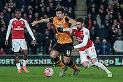 Olivier Giroud (Arsenal) and Harry Maguire (Hull City) fight for the ball in the penalty box during the The FA Cup fifth round match between Hull City and Arsenal at the KC Stadium, Kingston upon Hull, England on 8 March 2016. Photo by Mark P Doherty.