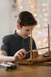 Boy Working on Model Ship