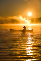 Canoeing at sunrise, Moosehead Lake, Maine. (MR)