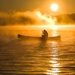 Canoeing at sunrise, Moosehead Lake, Maine. (MR)