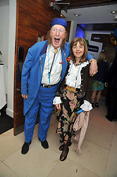 John McCririck and his wife Jenny at the launch of the 2009 Derby Festival in the presence of HRH Princess Haya of Jordan in aid of the charity Starlight held at the Kensington Roof Gardens, 99 Kensington High Street, London W8 on 12th May 2009.
