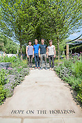 Young designers vying for RHS Chelsea Flower Show honours.<br /> Photographed on the 'Hope on the Horizon' garden, in aid of Help for Heroes.<br /> L-R David Rich (23, Vital Earth The Night Sky), Hugo Bugg (27, RBC Waterscape Garden), Matthew Keightley (29, Hope on the Horizon), Harry Rich (26, Vital Earth The Night Sky).  The<br /> &lsquo;Hope on the Horizon&rsquo; garden in aid of Help for Heroes: produced by building and landscaping firm Farr and Roberts&rsquo;, making their debut; designed by Matthew Keightley (29), as a result of his brother Michael&rsquo;s involvement with the armed forces, having served on four tours to Afghanistan and due for his fifth this year; and sponsored by the David Brownlow charitable foundation. The garden layout is based on the shape of the Military Cross, the medal awarded for extreme bravery. Granite blocks will represent the soldiers&rsquo; physical wellbeing and the planting represents their psychological wellbeing at various stages of their rehabilitation. Both evolve through the garden from a rough, unfinished, over-grown beginning through to a perfectly sawn, structured end. An avenue of hornbeams draws the attention through the entire garden to a sculpture resembling a hopeful horizon; a reminder to the soldiers that they all have a bright future ahead. As well as areas to recline and reflect, the garden offers focal points all the way through. Cool, calming colours are used throughout, helping to emphasise the fact that it will be a serene, contemplative space. After the Show, the garden will be moved and set within the grounds at Help for Heroes Recovery Centre at Chavasse VC House in Colchester, Essex. The garden will offer a serene, peaceful haven to contemplate and inspire a bright future and to support the challenging journey to recovery. The Chelsea Flower Show 2014. The Royal Hospital, Chelsea, London, UK