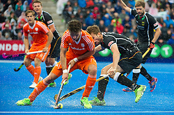 The Netherlands Robbert Kemperman is watched by Constantin Staib. The Netherlands v Germany - Final Unibet EuroHockey Championships, Lee Valley Hockey & Tennis Centre, London, UK on 29 August 2015. Photo: Simon Parker