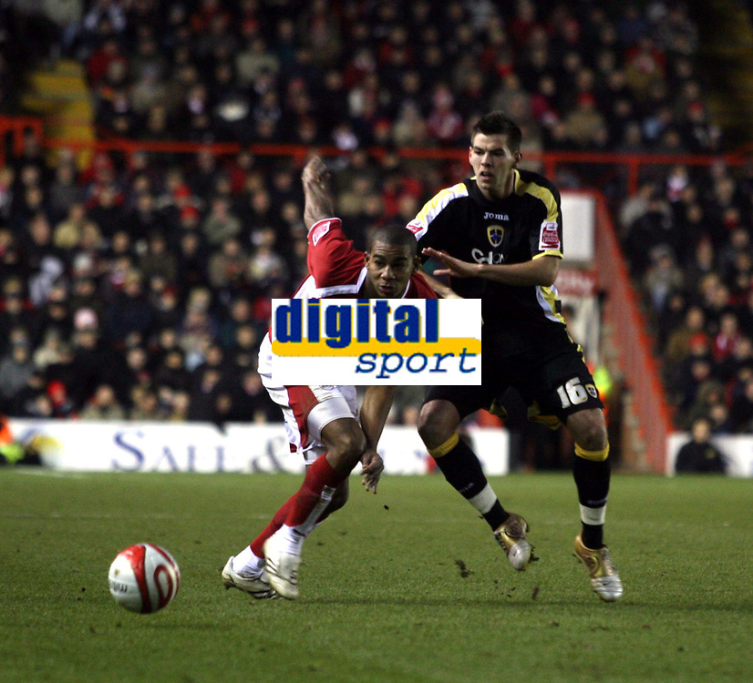 Photo: Mark Stephenson/Sportsbeat Images.<br /> Bristol City v Cardiff City. Coca Cola Championship. 15/12/2007.Bristol's Marvin Elliott holds off Cardiff's Joe Ledley