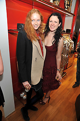 Left to right, LILY COLE and KATIE GRAND at a party in aid of the charity Best Buddies held at the Hogan store, 10 Sloane Street, London SW10 on 13th May 2009.
