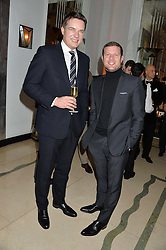 Left to right, THOMAS KOCHS and DERMOT O'LEARY at a reception hosted by Wei Koh founder of The Rake Magazine and Thomas Kochs General Manager of Claridge's to celebrate London Collections: Man 2014 at Claridge's, Brook Street, London on 5th January 2014.